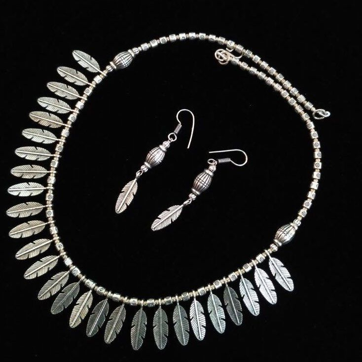 A very subtle variation of our classic feather necklace