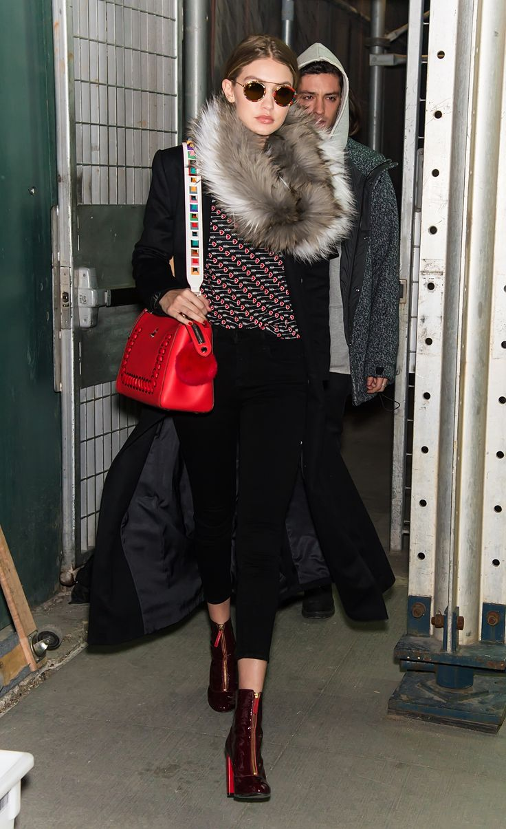 Super Model Gigi Hadid spotted in New York with her new Fendi DotCom bag and multicolored StrapYou.