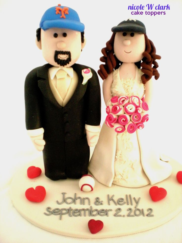 NEW YORK METS & NEW YORK YANKEES WEDDING CAKE TOPPER.  Custom made wedding figures that support your favourite baseball team by Nicole W Clark .  Personalized figures made by www.nicolewclark.com can be shipped to anywhere in the world.  #baseballweddingtopper #NYweddingcaketopper #NEWYORKMETSWEDDING