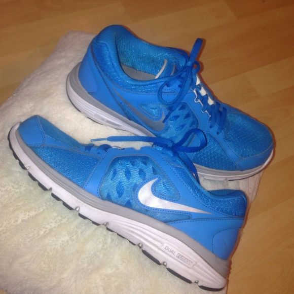 Nike Dual Fusion Beautiful Blue Final Sale Great condition these have been cleaned so they are really nice and the color is so pretty! You will love this bright blue color I tried taking care of them so they are in used but good condition!  let me know if you have any questions Nike Shoes Athletic Shoes
