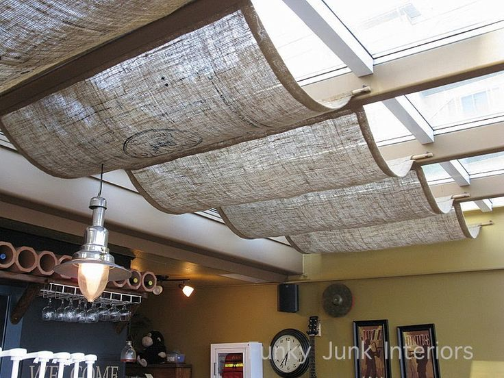 Burlap held up with bamboo poles! Simple, very effective and wonderfully rustic casual. Via Funky Junk Interiors.