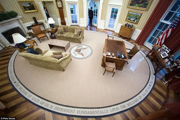 Official White House photographer Pete Souza snaps the final pictures of Barack Obama's pr...