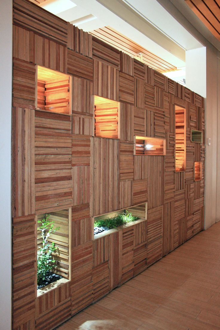 Custom designed + handmade water feature out of recycled timber. Also forming a feature wall and room divider!