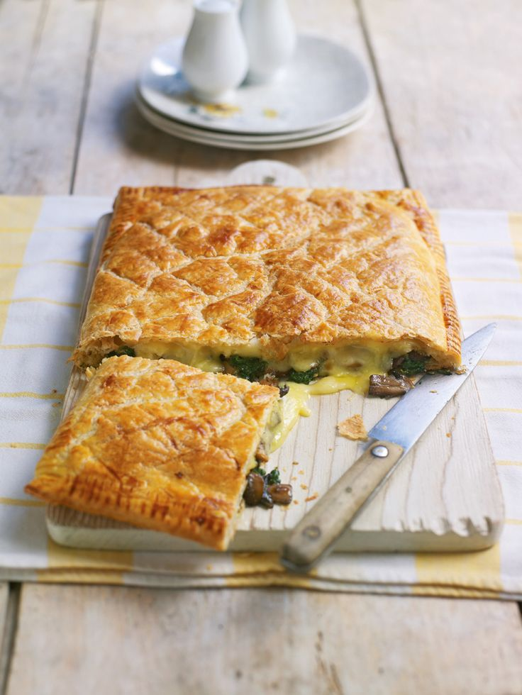 Use ready-rolled puff pastry to make this easy vegetarian tart recipe. Try using Taleggio or Camembert instead of Brie, and thyme or lemon thyme instead of rosemary.