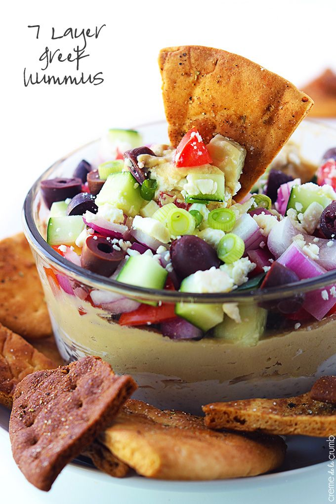 This Greek-inspired hummus dip has 7 tasty layers and comes together in just minutes! Easy, healthy, and crazy delicious!