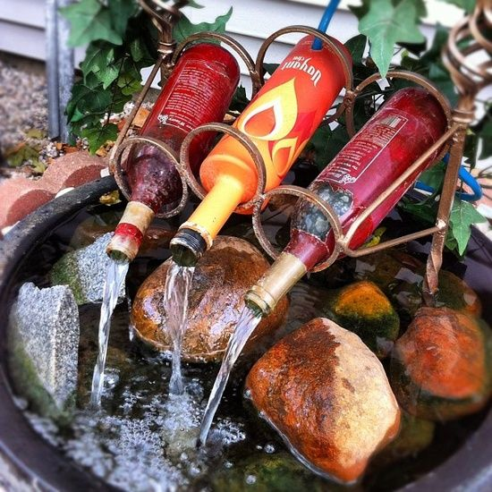 Love this fountain. What a great use for old wine bottles.