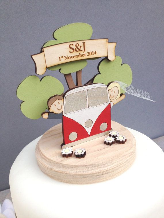 Bride & Groom in camper van - Wedding Topper  Description ------------- A delightful wooden cake topper featuring a cute Bride and Groom sitting in a campervan in front of a tree. The figures are laser cut from wood, hand painted and mounted on a solid ash wood base. A lovely way to give your wedding cake a personalised touch and to keep as a memento of the day for years to come .Each topper is made to order. Details on how to personalise are as below in How to order.  Size. Height 12 cm…