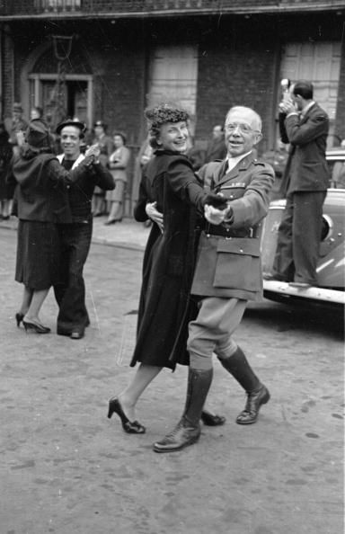 14th July 1943: Despite the war, French people in London celebrate France's Bastille Day by dancing in the streets. They are commemorating the storming of the Bastille prison in Paris on July 14th 1789, during the French Revolution. Original Publication: Picture Post - 1493 - Street Dancing For France's July 14th - pub. 1943 (Photo by Leonard McCombe/Picture Post/Getty Images)