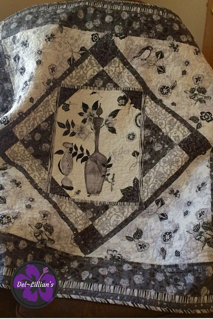 A personal favorite from my Etsy shop https://www.etsy.com/listing/387456080/art-quilt-handmade-wall-quilt-floral
