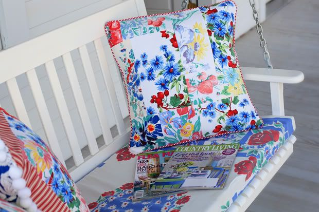 Using vintage tablecloths to make pillows.