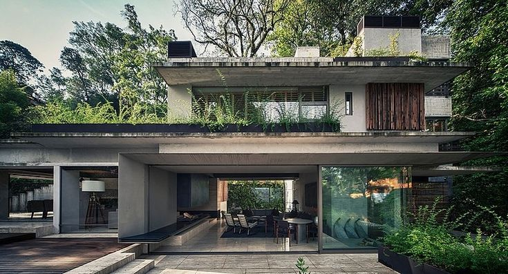 horizontal lines, might be too open or it could let too many bugs in, especially in the forest like that --- House by the Lake by CHK Arquitectura