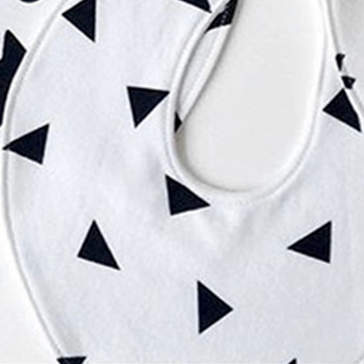Monochrome triangle cotton baby bibs available at Desa Life. www.desa.life