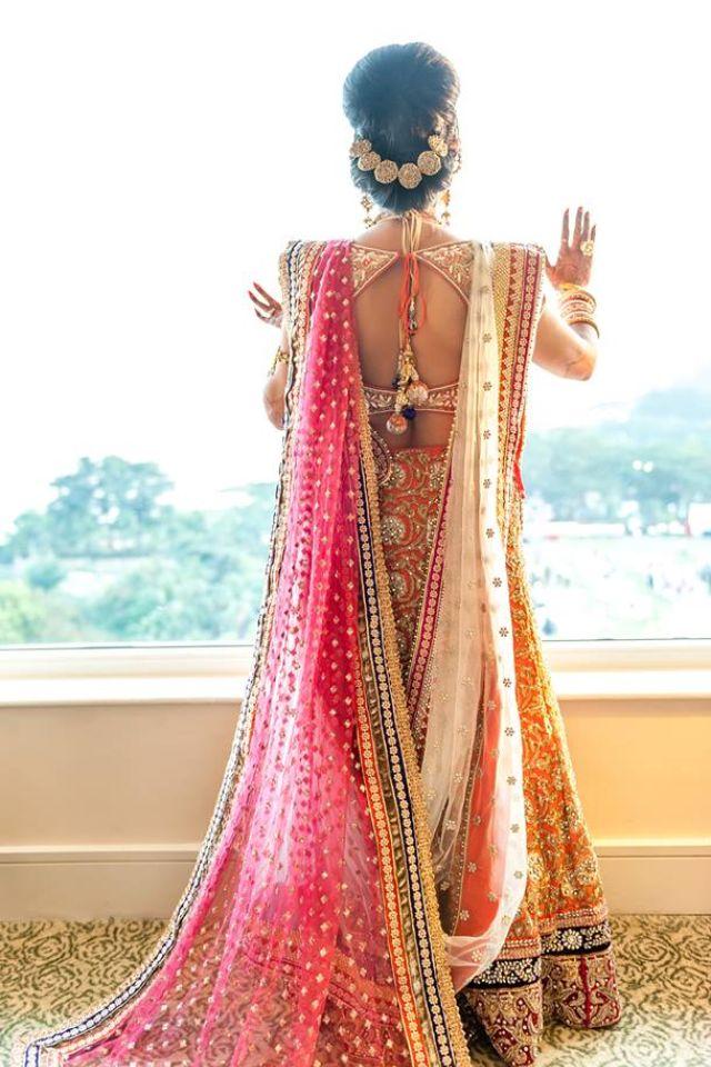 Indian bride wearing bridal lehenga and jewelry. #IndianBridalHairstyle #IndianBridalFashion Shruti Sheth Couture Mumbai......blouse back design