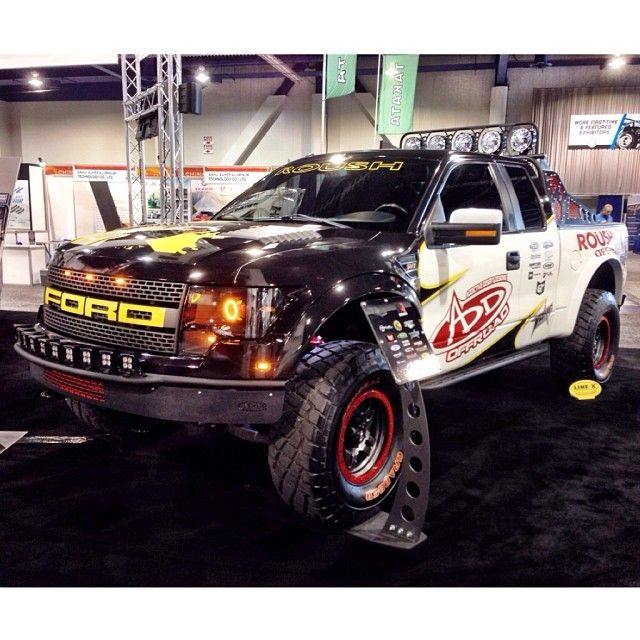 One of the Ford Raptors we took to SEMA 2013. This had our new Front & Rear Race Series R Bumpers, and a custom bed cage. Lighting was from Rigid Industries and KC Hilites