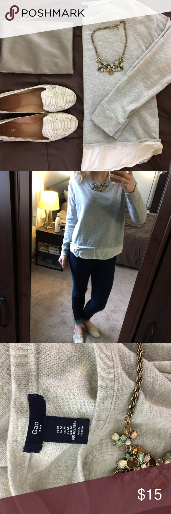 ADORABLE GREY SWEATER Soft, light grey sweater with attached details at bottom to look like it has an undershirt. Perfect for a spring day date or a day in the office. Pair with a blazer to dress up or destroyed denim and heeled sandals for a dress down. GAP Tops Tees - Long Sleeve