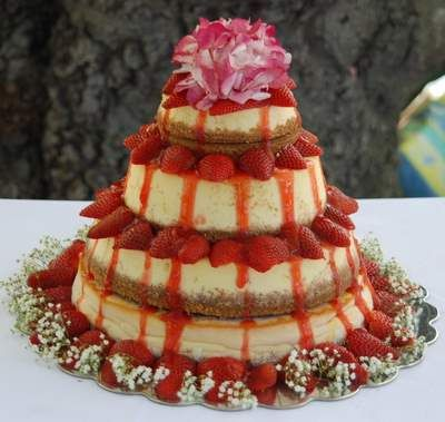 Layered Strawberry Cheesecake with Flowers. This is my wedding cake!! Unique and delicious!!