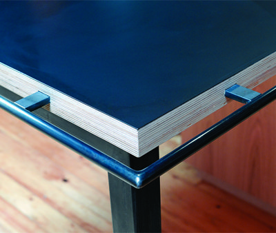FHB Oct 2013: like the thin legs (never like the thick Victorian furniture Schlick), grab bar also slick. Finished on site. The steel parts were coated with gun blue to bring them into the tonal range of the laminate countertop. Penetrol then was...