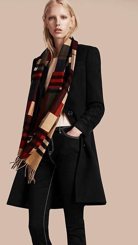 The Classic Cashmere Scarf from Burberry in check with colour block print is made at a 200-year-old mill in the Scottish countryside. The fabric is washed in local spring water and carefully brushed with teasels for a super-soft finish.
