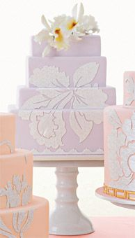 Brides: Wedding Cake Shapes :  Rectangle    Rectangular stacked layers give an artistic edge to this vanilla cake filled with blackberry and chocolate cream and covered in fondant. Serves 90, $1,350, by Ron Ben-Israel Cakes.