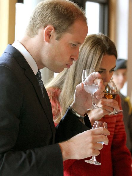 Catherine, Duchess of Cambridge and Prince William, Duke of Cambridge taste whisky during a tour of The Famous Grouse Distillery on May 29, 2014 in Crieff, Scotland.