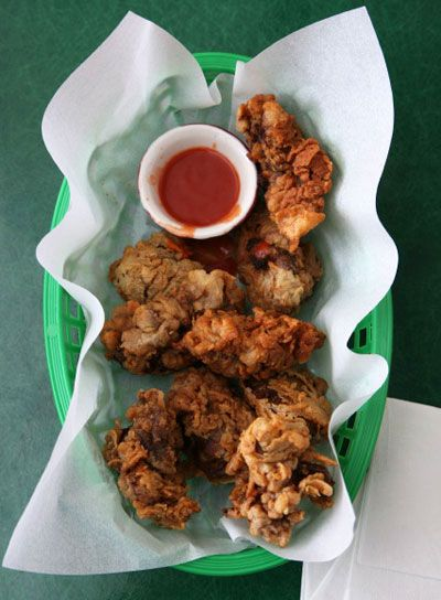 Fried Chicken Livers - canola oil for frying - chicken livers - buttermilk - self rising flour - kosher salt - poultry seasoning - hot sauce for dipping