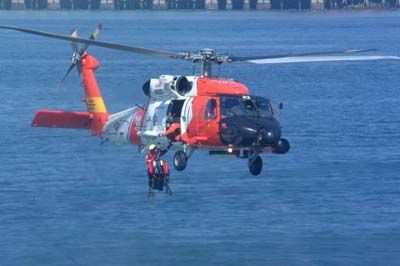 An HH-60 Jayhawk helicopter from Coast Guard Air Station Astoria, Ore., What is cooler than an orange and white helicopter?