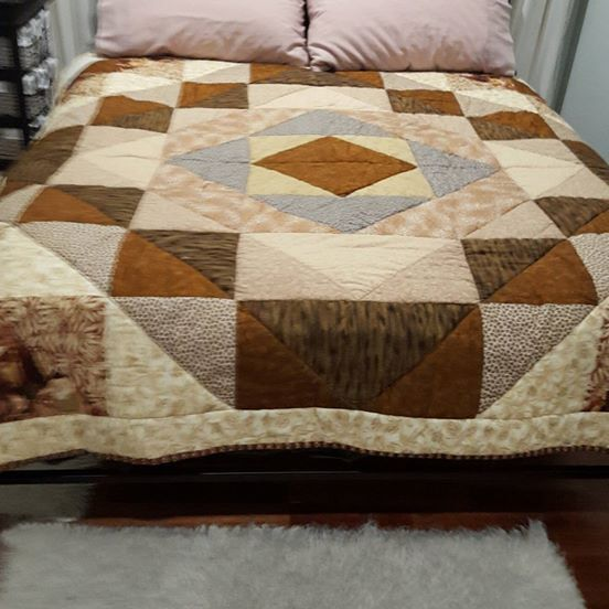 Beautifully made patchwork quilt made with excellent quilting cotton. Neutral diamonds shown on double bed. Perfect for a single / king single bed, as it would overhang the sides Perfect for those who love neutral colour schemes  185cm x 185cm quilting cotton with cotton wadding  Machine washable, line dry.