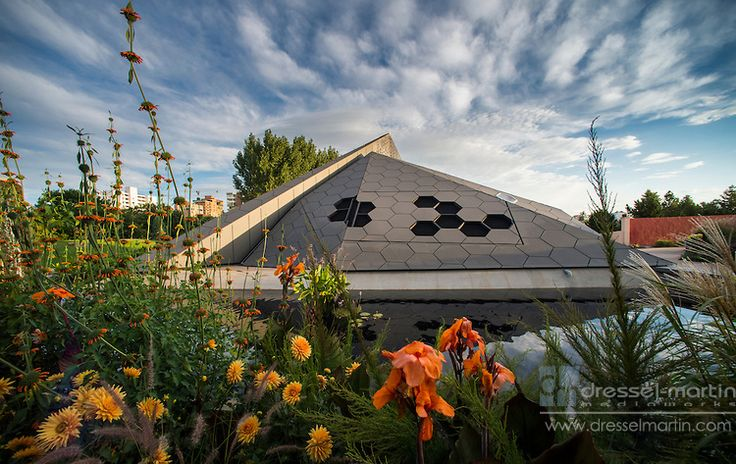 Denver Botanic Gardens' Science Pyramid perches on the edge of a waterway lined by flora | Dressel-Martin MediaWorks