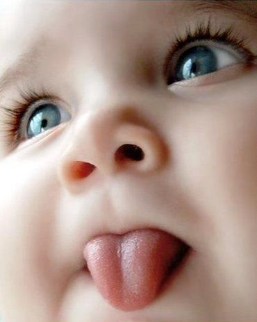 Look at her tiny baby tongue! Perfectly cropped photo that captures emotions and depth. LOVE it!