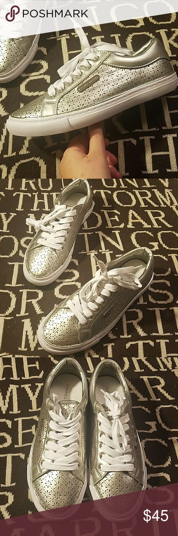 New silver cutout chic sneakers eyelet Ivanka trum Brand new without box women's beautiful silver eyelet cut-out sneakers with white laces and white accents Ivanka Trump sneaker shoes these are heavy there are very nice quality they are somewhat metallic but not overwhelming I have size 6 and size 9 women's available super cute especially for the spring these or not so much made for running but more for casual wear send me an offer I'm pretty flexible but no trades Ivanka Trump Shoes…
