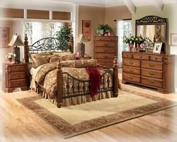 Ashley Wyatt Iron Poster King Size Bedroom Set in Rich Oak Finish