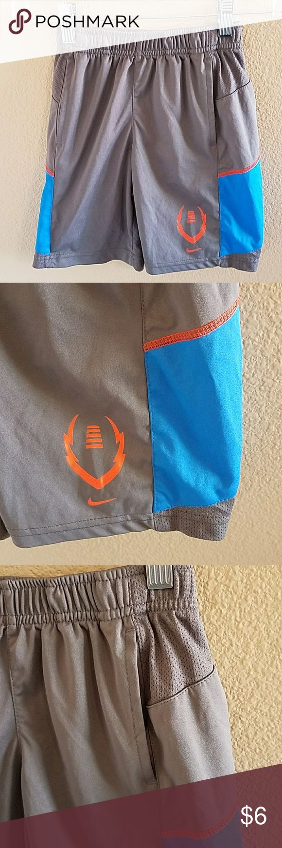 Nike Dri Fit Boys Basketball Shorts size 5 Nike Dri Fit Boys Basketball Shorts size 5 With accents of Blue and Orange. Pockets on front. Great condition overall but the last Pic is showing where the Dri Fit Iron On is mostly gone Nike Bottoms Shorts