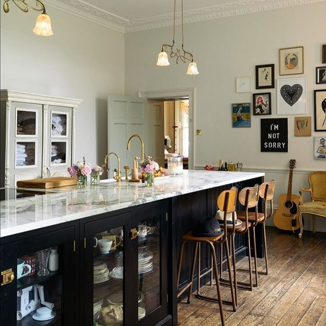 A wonderfully big Shaker island painted in Printer's Black with glazed base cupboards, a cool little breakfast bar seating area and a huge slab of bold marble on top. Perfection. #deVOLKitchens