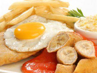Suprema Maryland (Chicken supreme+fried banana+cream corn+fried potatoes+fried egg+peppers)