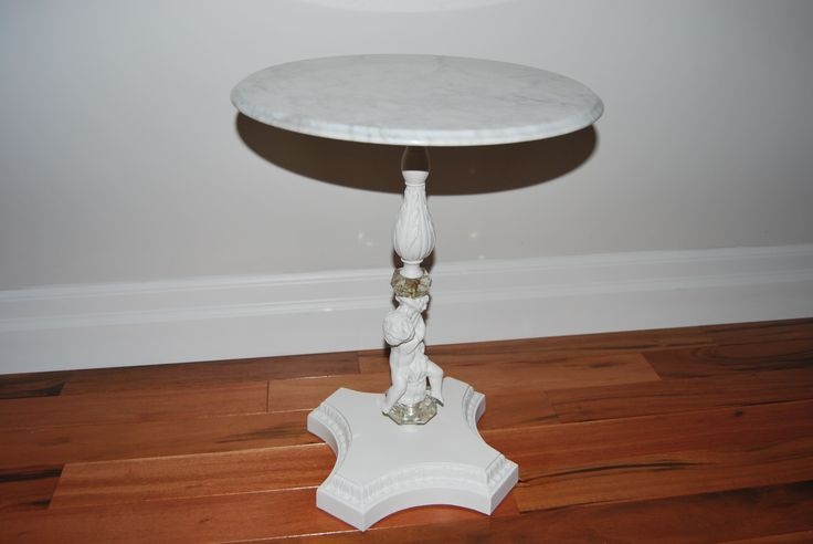 Painted Accent table. Re-finished this table simply by painting the base in a soft white. Top is carrara marble.