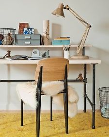 Some metal pipe and flanges, a sheet of plywood, and a drill are all it takes to make your own industrial-chic furniture.