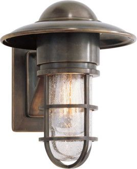 MARINE WALL LIGHT traditional wall sconces.   $210.00	  When searching for lighting, don't rule out bringing outdoor style lights indoors. This wall sconce will add industrial style to your interior. It also has nautical style, making it a great choice for a coastal cottage.