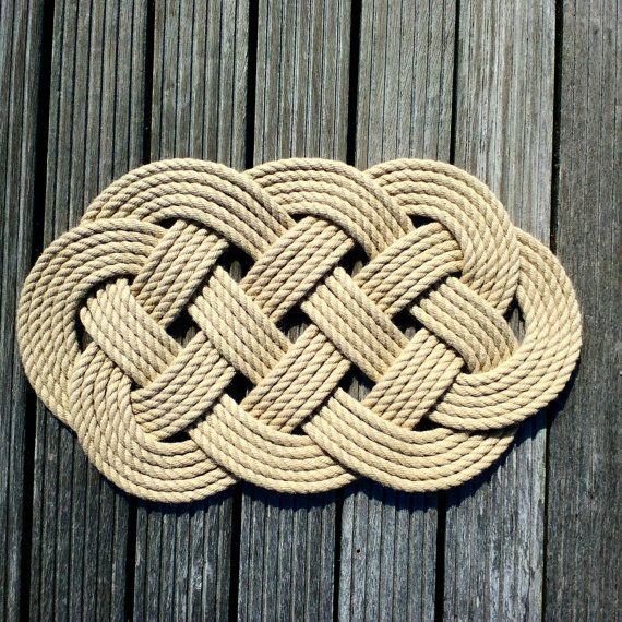 Nautical Rope Mat, the knot is called an Ocean Plait.   Dimensions are approximately 480 mm (19) x 300 mm (11).  Sailors used to make this knot with old rope, but our five passes mat is tied with new 10 mm marine hempex which is traditional looking in colour. This door mat would be ideal for interior or outside use, on the deck of a yacht or on decking in the garden. One of our customers bought one for husbands shed! It would also look great indoors in a boaty bathroom, rustic kitchen or by…