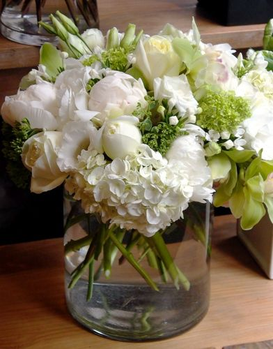 VSF - Peonies, roses, hydrangea, bovardia, and orchids arranged in a clear cylinder.