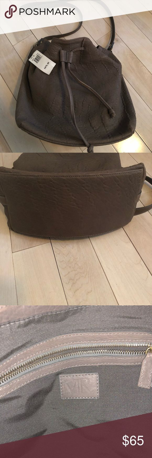 MR Bucket Handbag Brand new never worn Mr leather bucket bag. Very stylish, spacious and gorgeous neutral color. Comes from pet free, smoke free home. MR Bags Crossbody Bags