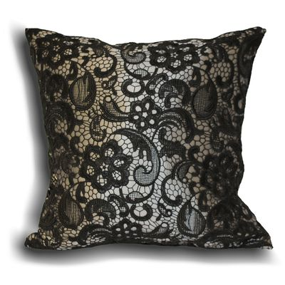 A floral lace feather filled cushion with beautiful stencil overlay.