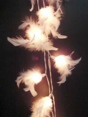 White feather light garland.  Ethereal!!  Just hot glue white feathers (or you could just wrap a white boa) around a string of white twinkle lights!