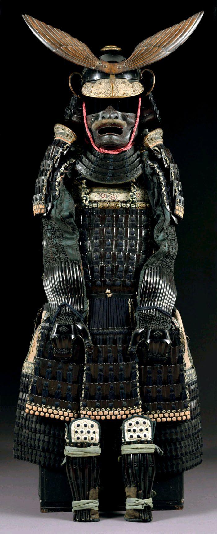 Blue Laced Rokumai Do Gusoku. Edo period (18th century). The Kabuto bowl of four heavy iron plates and lacquered black. A Rokumai do (six-piece cuirass) of yahazu-shaped lamellae applied with stenciled doeskin munaita.  Accompanied by a certificate of registration as Koshu tokubetsu kicho shiryo (Especially important armor object) no. 24 issued by the Nihon Katchu Bugu Kenkyu Hozon Kai (Japanese Armor Preservation Society)