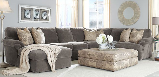 Here's a family room sectional sofa.. big enough for the entire family, with deep, sink into it soft seating... and an oversized ottoman for everyone to put their feet up!  http://www.dhifurniture.com