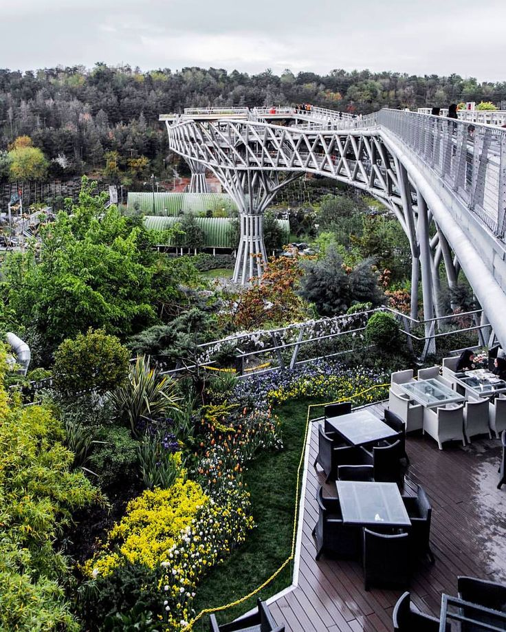 """Beautiful capture of """"Tabiat"""" bridge on a rainy day .  Tabiat Bridge is the biggest pedestrian overpass built in Iran and connects two public parks by spanning over one of the main highways in northern Tehran. """"Tabiat"""" means nature in persian . Location: city of #Tehran - IRAN . ==============  #tourism_iran . . Photo by: @arzhang_sahabi . . شنبه همگی خوش تصویری زیبا از پل طبیعت تهران در یک روز بارانی پ ن: اینجا برای قدم زدن دو نفره عالیه by tourism_iran"""