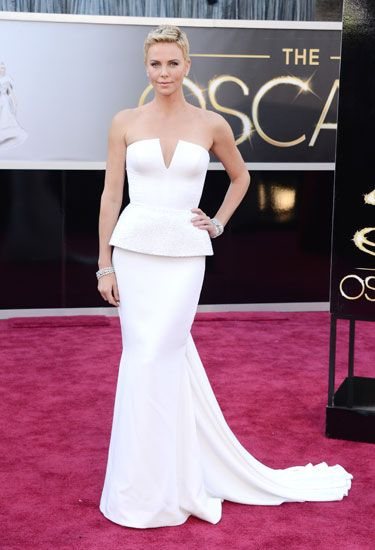 Charlize Theron in a sculptural Dior Couture gown and jewelry by Harry Winston.  Read more: Oscars Red Carpet 2013 - Pictures from 2013 Academy Awards Red Carpet - Harper's BAZAAR  Follow us: @Kerry Pieri on Twitter   HarpersBazaar on Facebook  Visit us at HarpersBAZAAR.com