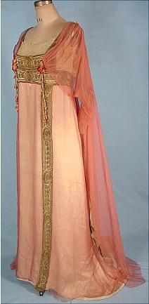 """c. 1912 JEANNE HALLEE, Paris Pink Gossamer Silk Chiffon Edwardian Gown.  A beautiful rose pink gossamer chiffon draped over an underdress of ivory """"peau-de-cygne (swan-skin - a kind of textured satin). It's trimmed under with embroidered gold net and pendant sprays of silk rose buds.  (No longer for sale at this site, but they have many detail photos, front/back/side views, for reference.)"""