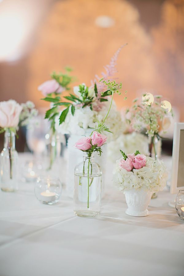 mixed vases for centerpieces // photo by Our Labor of Love by Heidi, styling by @Simply Charming Socials http://ruffledblog.com/atlanta-arts-center-wedding #centerpieces #flowers #vases #glassbottles