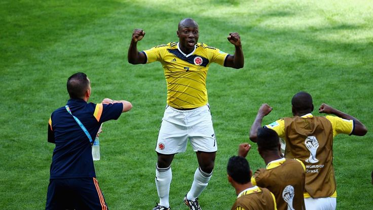 Pablo Armero of Colombia celebrates with his team-mates