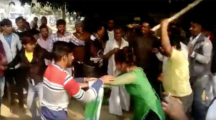 A woman was beaten at a marketplace in India by men who allegedly attempted to molest her. The victim of the assault has reportedly threatened to shoot herself if her attackers are not brought to justice.  Video of the incident, which took place in Uttar Pradesh in India's Mainpuri district, shows the woman in a brawl with a group of men when another man approaches with a large stick and proceeds to strike her with it.      The woman reportedly asked men at the market for directions before…